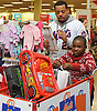 Dominic Smith, New York Mets rookie first baseman, helps David Oche, 7, fill his cart during the team's Holiday Shopping Spree at Target in Elmhurst, NY on Wednesday, Nov. 29, 2017.