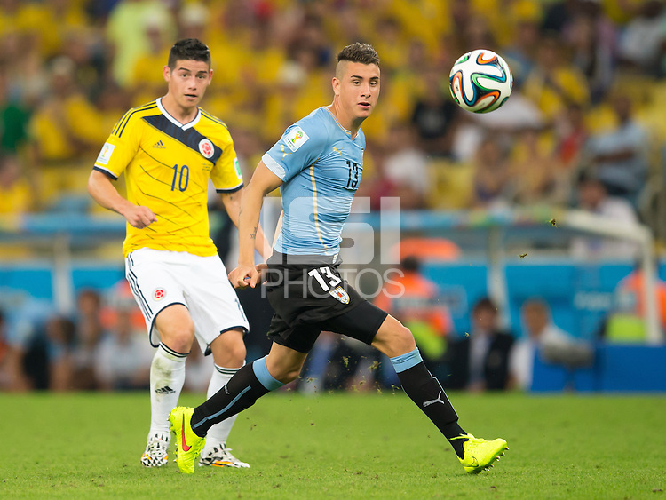 Jose Gimenez of Uruguay and James Rodriguez of Columbia