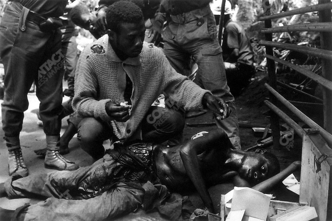 Wounded soldier attended by Ibo medic, civil war, Biafra, Nigeria, April 1968