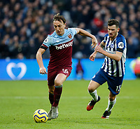 1st February 2020; London Stadium, London, England; English Premier League Football, West Ham United versus Brighton and Hove Albion; Mark Noble  of West Ham United gets away from Pascal Gross of Brighton and Hove Albion