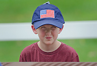 Michael McCollum<br /> 8/2/18<br /> Alex Overman,7, at the reveal ceremony where it was announced to 13 year old Ryan Overman of west Knoxville that The Wish Connection is granting Ryan&rsquo;s wish to go to Washington DC and visit the White House at Carl Cowan Park, 10058 S Northshore Dr, Knoxville, TN&nbsp;, Thursday, August 2, 2018 at 5:45pm. Approximately 50-60 people attended, including the Overman family, friends, and AT&amp;T Employees. The Bearden High School Cadets also attended and lead the pledge of allegiance.<br /> &nbsp;The AT&amp;T Wish Connection is going to send Ryan, his family, and his service dog to Washington DC and while they are gone, the group of volunteers will be doing a makeover on his bedroom and turn it into the &quot;Oval Office&quot; at the White House.<br /> Ryan was born two weeks prematurely on May 13, 2005.&nbsp; During the pregnancy he was classified as high risk due to a measured lack of growth and, after a brief stay in the hospital, he came home weighing only 4 lbs 5 oz.&nbsp; His development was much slower compared to his peers, such as not learning to walk until he was well over a year old, and he was much smaller. The Overman family worked with Tennessee Early Intervention Services (TEIS) when Ryan was about one year old and with their help they were able to get Ryan enrolled through TEIS to receive Occupational, Physical, and Speech Therapy.&nbsp; When Ryan turned three he transitioned from TEIS to the Knox County Early Intervention Program and began attending a special school to continue his therapies until he was old enough to enroll at Cedar Bluff Elementary and now is at Cedar Bluff Middle School. In 2016, Ryan was diagnosed to have retinitis pigmentosa, a degenerative disease of the retinas that under the best of circumstances causes severe tunnel vision, but more commonly results in complete blindness.<br /> &nbsp;Despite the physical difficulties that Ryan has had to endure over the last thirteen years, he continually brightens the lives of those around him.&nbsp; If someone is hurting or not f
