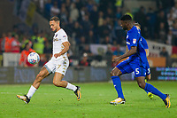 Kemar Roofe of Leeds United  and Bruno Manga of Cardiff City during the Sky Bet Championship match between Cardiff City and Leeds United at the Cardiff City Stadium, Cardiff, Wales on 26 September 2017. Photo by Mark  Hawkins / PRiME Media Images.