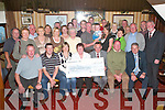 CHEQUE: Rosaleen Evans presents a cheque for 8,260 to Tom McCormack, in aid of Kerry Hospice, at Murphys Bar, Boolteens,.last Tuesday night. The money was raised by the Tom Evans Memorial Walk, which was held on Slieve Mish on Sunday June 4th.