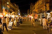Crowds of people at night in the old bazaar in Rawalpindi Pakistan