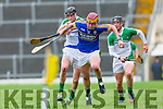 Kerry centre forward Michael O'Leary powers past Limerick's Diarmaid Byrne and Darragh O'Donovan during their NHL Div 1B clash in Fitzgerald Stadium on Sunday