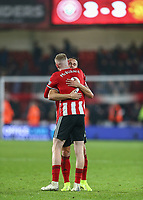 24th November 2019; Bramall Lane, Sheffield, Yorkshire, England; English Premier League Football, Sheffield United versus Manchester United; Oliver McBurnie of Sheffield United gets a hug from Phil Jagielka  of Sheffield United at the end of the match - Strictly Editorial Use Only. No use with unauthorized audio, video, data, fixture lists, club/league logos or 'live' services. Online in-match use limited to 120 images, no video emulation. No use in betting, games or single club/league/player publications