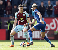Leicester City's Riyad Mahrez under pressure from Burnley's Stephen Ward<br /> <br /> Photographer Rich Linley/CameraSport<br /> <br /> The Premier League - Burnley v Leicester City - Saturday 14th April 2018 - Turf Moor - Burnley<br /> <br /> World Copyright &copy; 2018 CameraSport. All rights reserved. 43 Linden Ave. Countesthorpe. Leicester. England. LE8 5PG - Tel: +44 (0) 116 277 4147 - admin@camerasport.com - www.camerasport.com