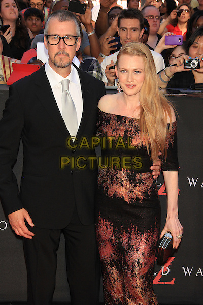 Alan Ruck &amp; Mireille Enos<br /> The New York Premiere of &quot;World War Z&quot; in Times Square, New York, NY., USA.<br /> June 17th, 2013<br /> half length dress suit white shirt glasses married husband wife black red orange off the shoulder pattern   <br /> CAP/LNC/TOM<br /> &copy;LNC/Capital Pictures