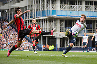 Christian Eriksen of Tottenham Hotspur shoots under pressure from Charlie Daniels of Bournemouth during the Premier League match between Tottenham Hotspur and Bournemouth at White Hart Lane, London, England on 15 April 2017. Photo by Mark  Hawkins / PRiME Media Images.