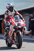 Ayrton Badovini (ITA) riding the Ducati Panigale 1199R (86) of the Team Ducati Alstare leaving the pits for a practise session on day one of round one of the 2013 FIM World Superbike Championship at Phillip Island, Australia.