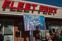 Olympic medalist, USA record-setter, and New York and Boston Marathon champion Meb Keflezghi speaks to the crowd outside of the Fleet Feet Des Peres store at the Run with Meb event in Des Peres, MO. Wednesday, September 3, 2014.