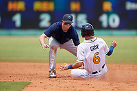 Mobile BayBears shortstop Connor Justus (7) tags Tristan Gray (6) sliding into second base during a Southern League game against the Montgomery Biscuits on May 2, 2019 at Riverwalk Stadium in Montgomery, Alabama.  Mobile defeated Montgomery 3-1.  (Mike Janes/Four Seam Images)