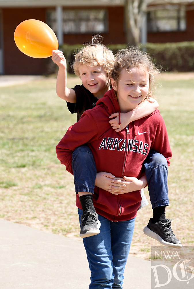 NWA Democrat-Gazette/DAVID GOTTSCHALK Zayna Walsh, 10, carries her brother Torin, 5, to a group activity Monday, March 18, 2019, as they participate in Spring Break Camp at Mount Sequoyah in Fayetteville. The weeklong camp offers different themed activities each day that includes Detectives, Sports, Science/Tech along with free time activities. Campers can register for a day or multiple days.