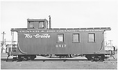 Long caboose #0517 in Alamosa yard.<br /> D&amp;RGW  Alamosa, CO  Taken by Maxwell, John W. - 1/18/1946