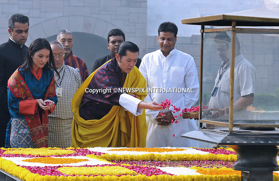 """KING AND QUEEN OF BHUTAN VISIT INDIA.The recently married King of Bhutan, His Majesty Jigme Khesar Namgyel Wangchuck and the Bhutan Queen, Her Majesty Jetsun Pema Wangchuck made their first foreign trip with a visit to India.The King Wangchuck married Jetsun Pema on 13th October, 2011..Picture Shows: The Royal couple paying floral tributes at the Samadhi of Mahatma Gandhi, at Rajghat, Delhi.Photo: ©Newspix International..**ALL FEES PAYABLE TO: """"NEWSPIX INTERNATIONAL""""**..PHOTO CREDIT MANDATORY!!: NEWSPIX INTERNATIONAL(Failure to credit will incur a surcharge of 100% of reproduction fees)..IMMEDIATE CONFIRMATION OF USAGE REQUIRED:.Newspix International, 31 Chinnery Hill, Bishop's Stortford, ENGLAND CM23 3PS.Tel:+441279 324672  ; Fax: +441279656877.Mobile:  0777568 1153.e-mail: info@newspixinternational.co.uk"""