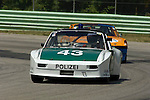 Timothy Green races his 1971 Porsche 914/6 followed by Michael Eisele in his 1970 Porsche 914/6 at The Brian Redman International Challenge at Road America, 2005.