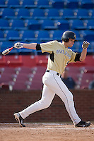 Austin Stadler #9 of the Wake Forest Demon Deacons follows through on his swing versus the Xavier Musketeers at Wake Forest Baseball Park March 7, 2010, in Winston-Salem, North Carolina.  Photo by Brian Westerholt / Four Seam Images