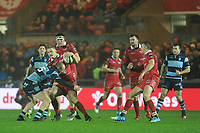 Johnny McNicholl of Scarlets is tackled by Dan Fish of Cardiff Blues during the Guinness Pro14 match between the Scarlets and Cardiff Blues at Parc Y Scarlets, Llanelli, Wales, UK. Saturday 22 December 2018