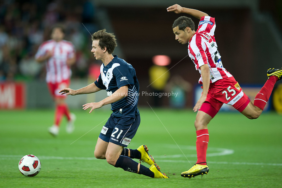 MELBOURNE, AUSTRALIA - DECEMBER 11: Robbie Kruse of the Victory is fould by Adrian Zahra of the Heart during the round 18 A-League match between the Melbourne Heart and Melbourne Victory at AAMI Park on December 11, 2010 in Melbourne, Australia. (Photo by Sydney Low / Asterisk Images)
