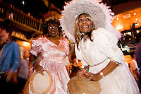 Geannie Thomas, right, and friend get all dolled up for the 8th annual Ponderosa Stomp, held at the House of Blues on April 28, 2010.  <br /> <br /> The Ponderosa Stomp is an annual music festival held in New Orleans since 2002 that celebrates the uncelebrated names in American musical history.  The festival spotlights musicians who have contributed to the American roots musical canon in various genres, from rockabilly to soul to rock and roll to jazz to experimental.  For two nights of the year these mostly forgotten names perform to an audience of aficionados whose memory has not faded and turn back the clock with blistering performances of the hits that did or (in the case of the regional musicians that plugged away unknown to the world at large, as well as those whose songs were recorded to acclaim by other musicians) did not make them famous.  <br /> <br /> In addition to the two nights of performances the Ponderosa Stomp Foundation (the non-profit founded by the eccentric Dr. Ira Padnos and his coterie of like minded music fanatics the Mystic Knights of the Mau Mau) also produces two days of the Music History Conference, where many of the performers, as well as other music industry names, share stories of their lives in the business.  The Conferences take place in the Louisiana State Museum at the Cabildo in Jackson Square.