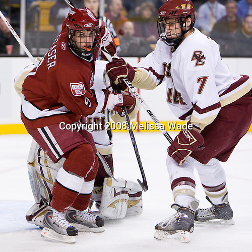 Carl Sneep (BC 7) battles with Jimmy Fraser (Harvard 9) in front of Muse. The Boston College Eagles defeated the Harvard University Crimson 6-5 in overtime on Monday, February 11, 2008, to win the 2008 Beanpot at the TD Banknorth Garden in Boston, Massachusetts.