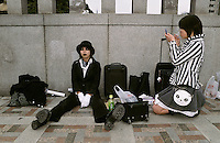 Cos play girls getting ready on the Meiji Jingu bridge in Harajuku, Tokyo, Japan 2006