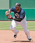 Reno Aces first baseman Josh Bells fields the ground ball and heads to first to get the out against the Sacramento River Cats during their game played on Sunday afternoon, July 29, 2012 in Reno, Nevada.