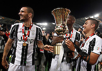 Calcio, finale Tim Cup: Milan vs Juventus. Roma, stadio Olimpico, 21 maggio 2016.<br /> From left, Juventus&rsquo;s Giorgio Chiellini, Paul Pogba and Paulo Dybala hold the trophy at the end of the Italian Cup final football match between AC Milan and Juventus at Rome's Olympic stadium, 21 May 2016. Juventus won 1-0 in the extra time.<br /> UPDATE IMAGES PRESS/Isabella Bonotto