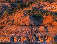NDTR_105 - USA, North Dakota, Theodore Roosevelt National Park, Sunset light defines eroded sedimentary hillside near Boicourt Overlook in the South Unit.
