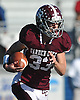 Chris Mixon #33 of Garden City rushes for a gain during the Nassau County varsity football Conference II final against Carey at Hofstra University on Saturday, Nov. 19, 2016.