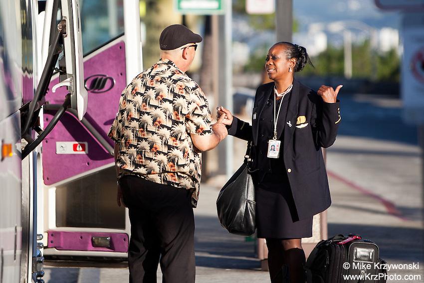American Airlines African American female empolyee talking to shuttle van bus driver at the Honolulu Airport, Oahu, Hawaii