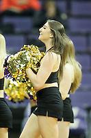SEATTLE, WA - DECEMBER 18: Washington cheerleader Tessa Locknane entertained fans during a timeout against Savannah State.  Washington won 87-36 over Savannah State at Alaska Airlines Arena in Seattle, WA.