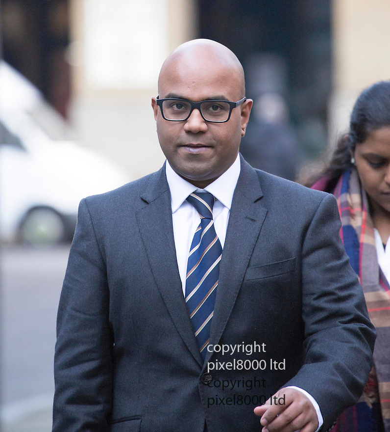 Pic shows: Dr Dhanuson Dharmasena arriving at Southwark Crown Court today 20.1.15<br /> <br /> <br /> A British doctor performed female genital mutilation on a young mother after she gave birth in hospital, a court has heard.<br /> <br /> Dhanuson Dharmasena, 32, is accused of carrying out the illegal procedure at the Whittington Hospital in north London.<br /> <br /> The doctor, of Ilford, London, denies the charge in what is the first prosecution of its kind in the UK.<br /> <br /> <br /> <br /> <br /> Pic by Gavin Rodgers/Pixel 8000 Ltd