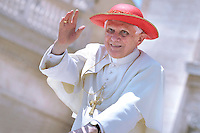 Pope Benedict XVI waves as he leaves his weekly general audience on June 2, 2010 at St Peter's square at The Vatican.