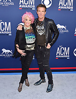 LAS VEGAS, CA - APRIL 07: Tanya Tucker (L) and Dennis Quaid attend the 54th Academy Of Country Music Awards at MGM Grand Hotel &amp; Casino on April 07, 2019 in Las Vegas, Nevada.<br /> CAP/ROT/TM<br /> &copy;TM/ROT/Capital Pictures