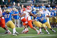 SAN FRANCISCO, CA - December 31, 2011: UCLA linebacker Erick Kendricks (30) attempts to tackle University of Illinois quarterback Nathan Scheelhaase (2)  at AT&T Park in San Francisco, California. Final score Illinois wins 20-14.