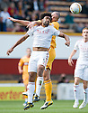 ABERDEEN'S YOUL MAWENE AND MOTHERWELL'S MICHAEL HIGDON CHALLENGE FOR THE HIGH BALL