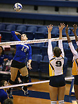 Marymount's Erin Allison hits against St. Mary's during a college volleyball game in Lexington Park, MD, on Wednesday, Oct. 29, 2014. Marymount won 3-2 to go 24-9 on the season.<br /> Photo by Cathleen Allison