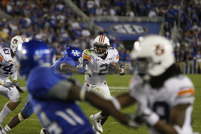 Quarterback Cam Newton rushes past a UK defender during the second half of UK's home game against Auburn, Oct. 9, 2010. Photo by Brandon Goodwin| Staff