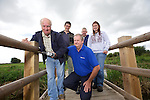 TATA Steel - Gwent Wildlife Trust<br /> <br /> Volunteer Gwyn Millward carrying out improvements at Magor Marsh Wildlife Centre watched by centre manager Richard Bakere, Mervyn West, Kimberley Williams and Keith Farron from TATA Steel who have donated money to improve accessibility to the area.<br /> 11.09.13<br /> <br /> &copy;Steve Pope-FOTOWALES