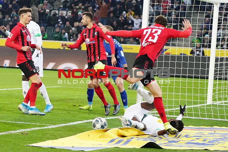 01.12.2019, Borussia Park , Moenchengladbach, GER, 1. FBL,  Borussia Moenchengladbach vs. SC Freiburg,<br />  <br /> DFL regulations prohibit any use of photographs as image sequences and/or quasi-video<br /> <br /> im Bild / picture shows: <br /> Breel Embolo (Gladbach #36),  wird von Dominque Heintz (Freiburg #23), gefoult1<br /> <br /> Foto © nordphoto / Meuter