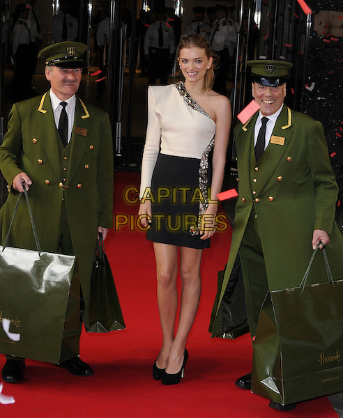 Lily Donaldson.opens the Harrods Summer 2012 Sale, Harrods, Knightsbridge,  London, England..16th June 2012.full length black white one shoulder sleeve embellished jewel encrusted dress skirt top uniform green bags shopping .CAP/CAN.©Can Nguyen/Capital Pictures.
