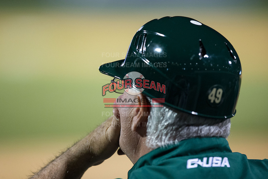 Charlotte 49ers head coach Loren Hibbs (49) looks on from the dugout during the game against the North Carolina State Wolfpack at BB&T Ballpark on March 31, 2015 in Charlotte, North Carolina.  The Wolfpack defeated the 49ers 10-6.  (Brian Westerholt/Four Seam Images)