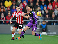 Lincoln City's Harry Anderson vies for possession with Port Vale's Luke Joyce<br /> <br /> Photographer Chris Vaughan/CameraSport<br /> <br /> The EFL Sky Bet League Two - Lincoln City v Port Vale - Tuesday 1st January 2019 - Sincil Bank - Lincoln<br /> <br /> World Copyright &copy; 2019 CameraSport. All rights reserved. 43 Linden Ave. Countesthorpe. Leicester. England. LE8 5PG - Tel: +44 (0) 116 277 4147 - admin@camerasport.com - www.camerasport.com