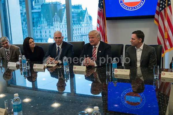 President-elect Donald Trump, Vice President-elect Mike Pence, cabinet nominees and technology company chiefs are seen at a meeting  in the Trump Organization conference room at Trump Tower in New York, NY, USA on December 14, 2016. Photo Credit: Albin Lohr-Jones/CNP/AdMedia