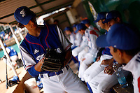 25 June 2011: Eloi Secleppe of Team France. Illustration of a photographic essay called Life in the dugout, during Czech Republic 11-1 win over France, at the 2011 Prague Baseball Week, in Prague, Czech Republic.