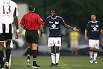 26 August 2011: Harrisburg's Brian Ombiji (KEN) (8) complains to referee Jose Carlos Rivero. The Harrisburg City Islanders defeated the Rochester Rhinos 2-1 in their USL PRO semifinal played at Sahlen's Stadium in Rochester, New York.