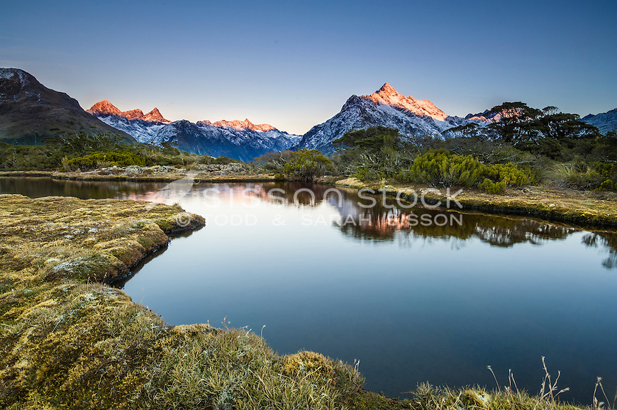 Sunrise on Mt Christina  seen from the tarns at Key Summit on the Routeburn Track, Fiordland  National Park, South Island, New Zealand - stock photo, canvas, fine art print