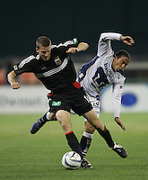 6 April 2005.  DC United's Josh Gros (17) is fouled by Pumas UNAM forward Ailton da Silva (10) during a CONCACAF Champion's Cup game at RFK Stadium in Washington, DC.