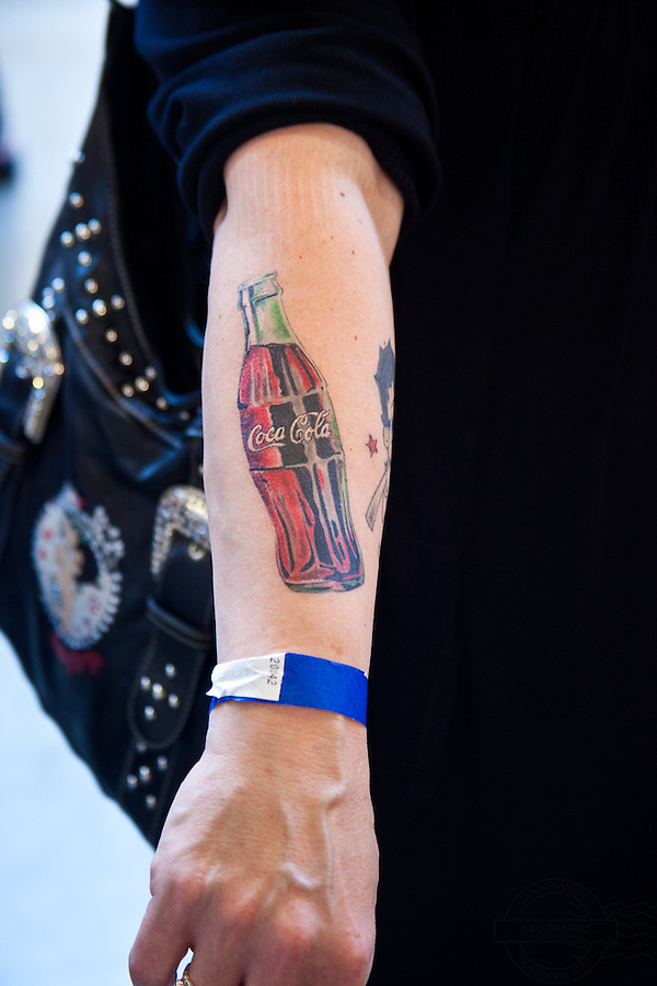 Copenhagen Inkfestival 2012. Tattoo of a Coca Cola bottle on arm.